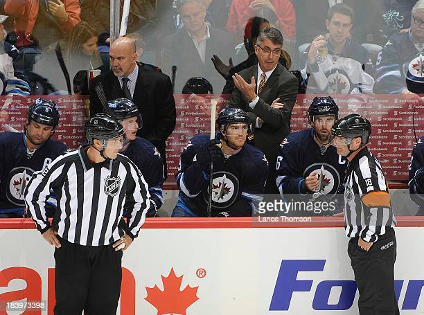 Winnipeg Jets Head Coach Claude Noel questions referee Greg Kimmerly during a second period stoppage against the Los Angeles Kings in the home opener...