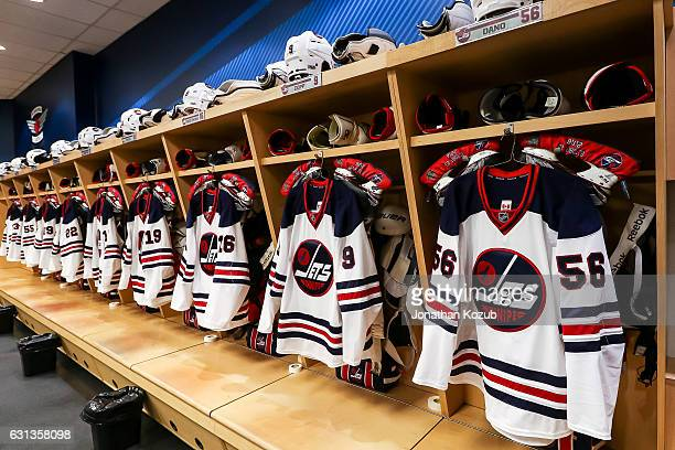 Winnipeg Jets Heritage jerseys hang in the locker room prior to NHL action against the Calgary Flames at the MTS Centre on January 9 2017 in Winnipeg...