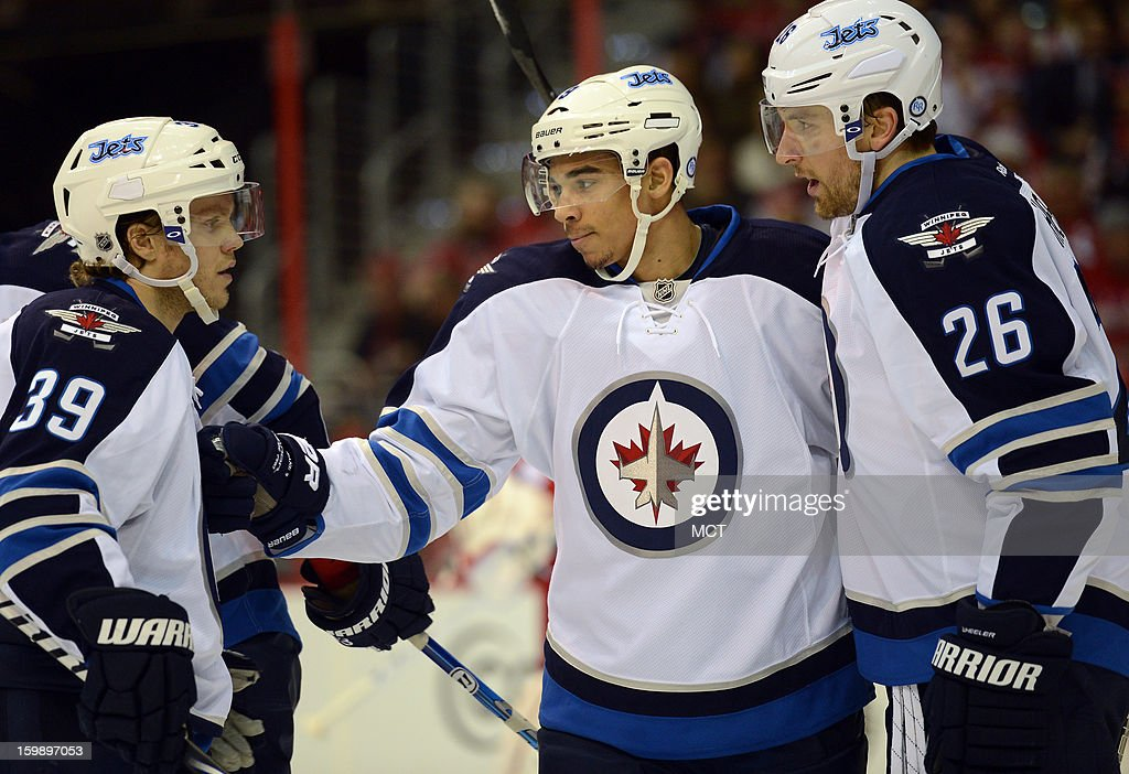 Winnipeg Jets left wing Evander Kane (9) celebrates with Jets right wing Blake Wheeler (26) and Jets defenseman Tobias Enstrom (39), following his power play goal against the Washington Capitals in the first period at the Verizon Center in Washington, D.C., Tuesday, January 22, 2013.