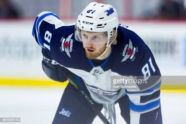 Winnipeg Jets Left Wing Kyle Connor prepares for a faceoff during first period National Hockey League action between the Winnipeg Jets and Ottawa...