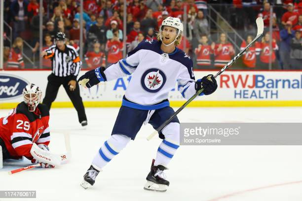 Winnipeg Jets left wing Kyle Connor skates during the National Hockey League game between the New Jersey Devils and the Winnipeg Jets on October 4,...