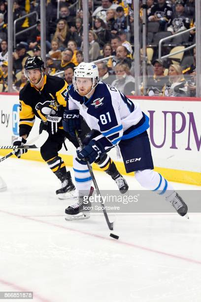 Winnipeg Jets Left Wing Kyle Connor skates with the puck during the third period in the NHL game between the Pittsburgh Penguins and the Winnipeg...