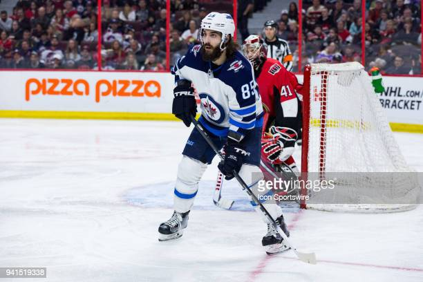 Winnipeg Jets Left Wing Mathieu Perreault sets up to the side of the Ottawa net during third period National Hockey League action between the...