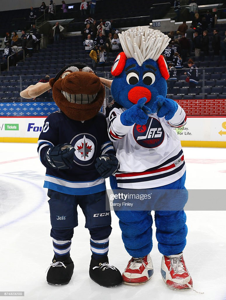 Winnipeg Jets mascot Mick E. Moose and Jets Heritage mascot Benny pose after celebrating a 4-1 victory over the Arizona Coyotes on Hall of Fame Night at the Bell MTS Place on November 14, 2017 in Winnipeg, Manitoba, Canada.