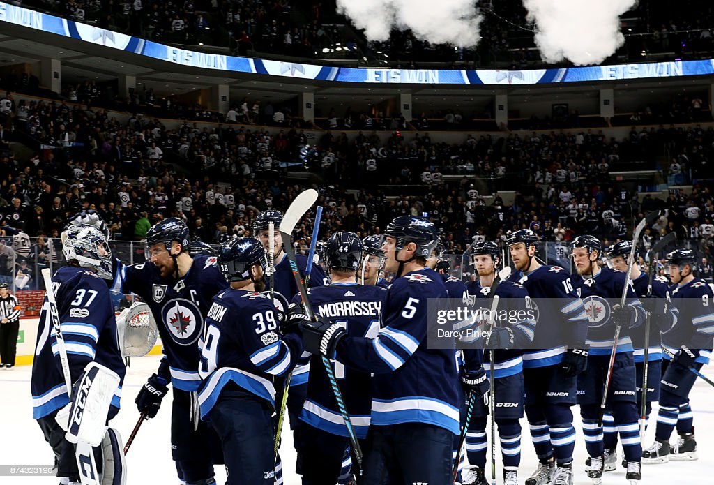 Winnipeg Jets players celebrate a 4-1 victory over the Arizona Coyotes at the Bell MTS Place on November 14, 2017 in Winnipeg, Manitoba, Canada.