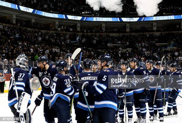 Winnipeg Jets players celebrate a 41 victory over the Arizona Coyotes at the Bell MTS Place on November 14 2017 in Winnipeg Manitoba Canada