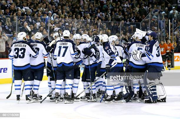Winnipeg Jets players celebrate a 43 overtime victory over the Anaheim Ducks at the MTS Centre on March 30 2017 in Winnipeg Manitoba Canada