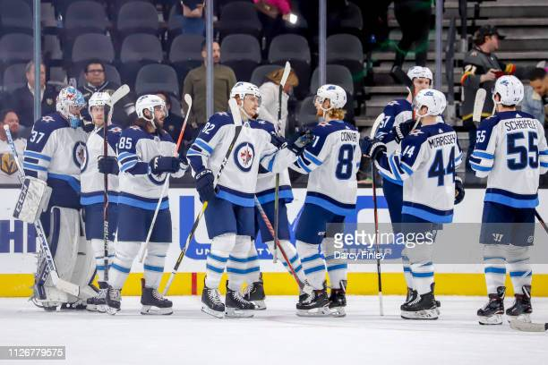 Winnipeg Jets players celebrate on the ice following a 63 victory over the Vegas Golden Knights at TMobile Arena on February 22 2019 in Las Vegas...