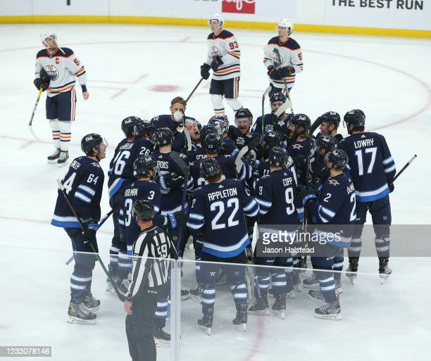 Winnipeg Jets players celebrate the overtime game-winning goal by Nikolaj Ehlers against the Edmonton Oilers in Game Three of the First Round of the...