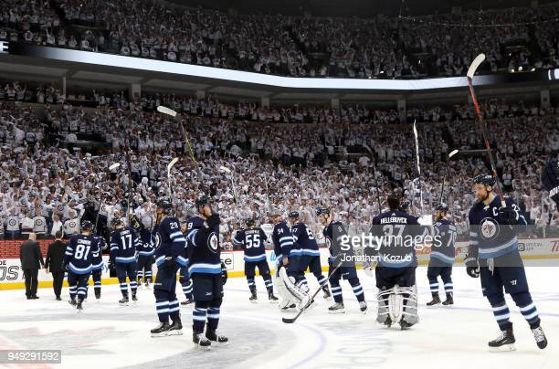 Winnipeg Jets players salute the fans following a 5-0 victory over the Minnesota Wild in Game Five of the Western Conference First Round during the...