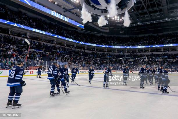 Winnipeg Jets players salute the fans following a 51 victory over the Dallas Stars at the Bell MTS Place on January 6 2019 in Winnipeg Manitoba Canada