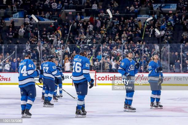 Winnipeg Jets players salute the fans following a 6-3 victory over the Los Angeles Kings at the Bell MTS Place on February 18, 2020 in Winnipeg,...