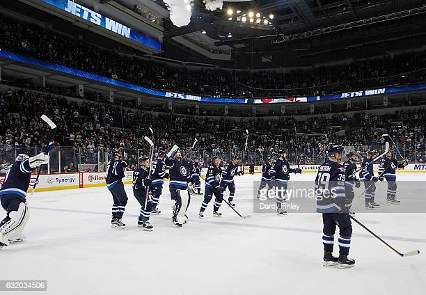 Winnipeg Jets players salute the fans following a 63 victory over the Arizona Coyotes at the MTS Centre on January 18 2017 in Winnipeg Manitoba Canada