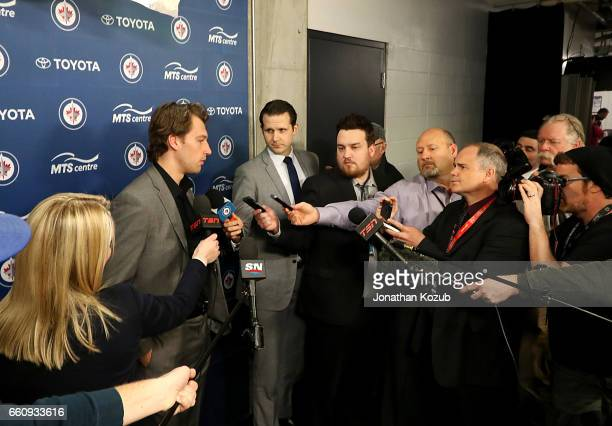 Winnipeg Jets prospect Tucker Poolman addresses the media after signing a oneyear entry level contract with the Jets prior to NHL action against the...