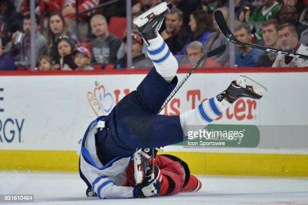 Winnipeg Jets Right Wing Blake Wheeler and Carolina Hurricanes Center Derek Ryan collide during a game between the Winnipeg Jets and the Carolina...