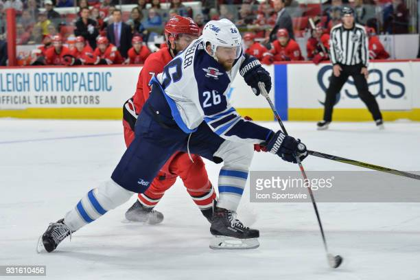 Winnipeg Jets Right Wing Blake Wheeler attempts a wrist shot during a game between the Winnipeg Jets and the Carolina Hurricanes at the PNC Arena in...