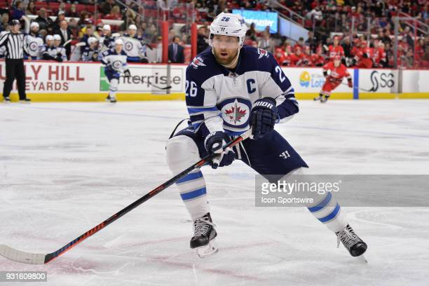 Winnipeg Jets Right Wing Blake Wheeler chases down a loose puck during a game between the Winnipeg Jets and the Carolina Hurricanes at the PNC Arena...