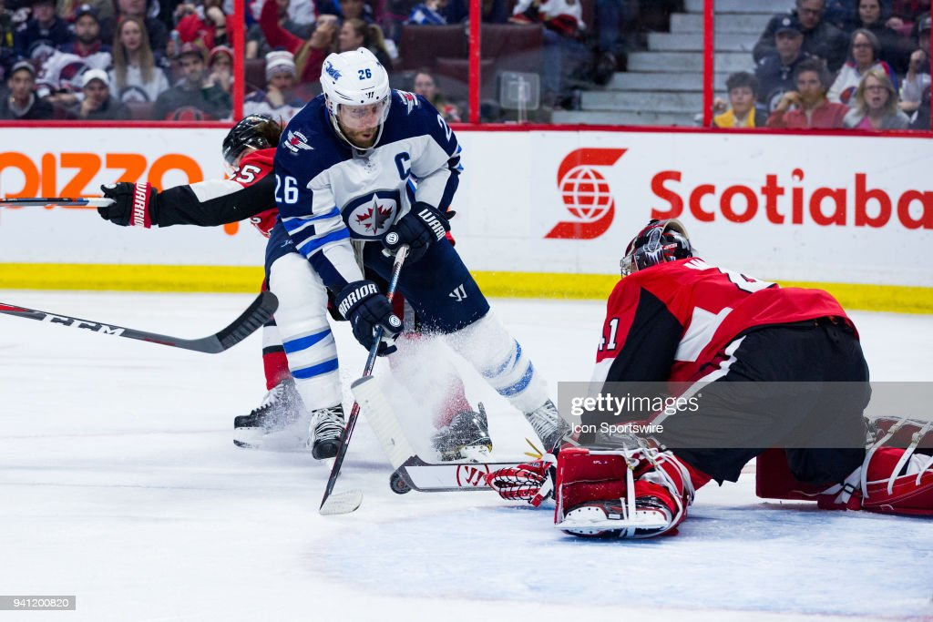 Winnipeg Jets Right Wing Blake Wheeler (26) tries to coral a rebound in front of Ottawa Senators Goalie Craig Anderson (41) during third period National Hockey League action between the Winnipeg Jets and Ottawa Senators on April 2, 2018, at Canadian Tire Centre in Ottawa, ON, Canada.