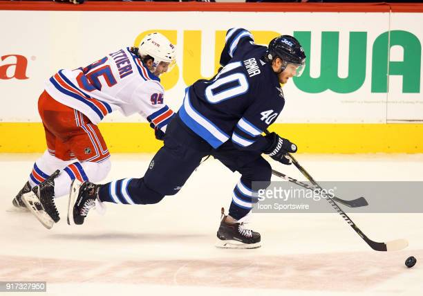 Winnipeg Jets Right Wing Joel Armia skates with the puck as New York Rangers Right Wing Vinni Lettieri gives chase during a NHL game between the...