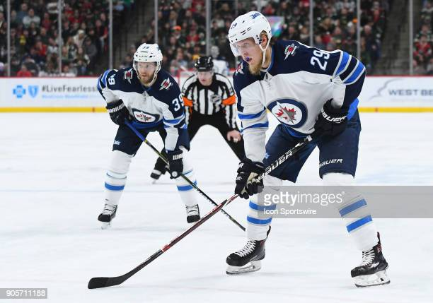 Winnipeg Jets Right Wing Patrik Laine and Winnipeg Jets Defenceman Toby Enstrom line up during a NHL game between the Minnesota Wild and Winnipeg...