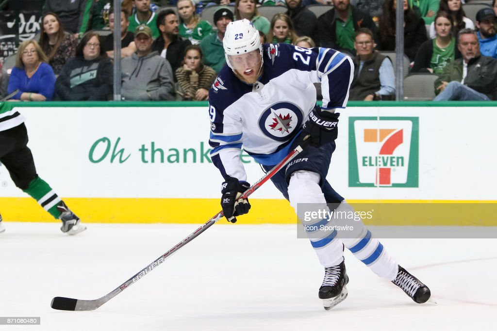 Winnipeg Jets Right Wing Patrik Laine (29) chases down the puck during the NHL game between the Winnipeg Jets and Dallas Stars on November 6, 2017 at American Airlines Center in Dallas, TX.