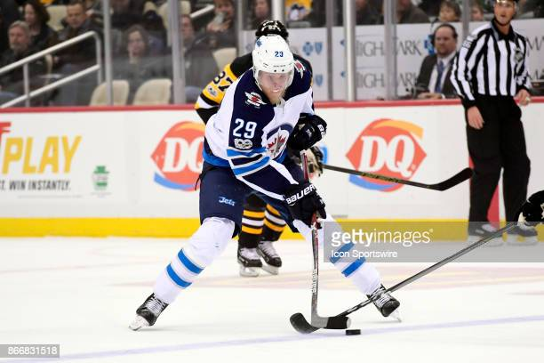 Winnipeg Jets Right Wing Patrik Laine skates with the puck during the first period in the NHL game between the Pittsburgh Penguins and the Winnipeg...