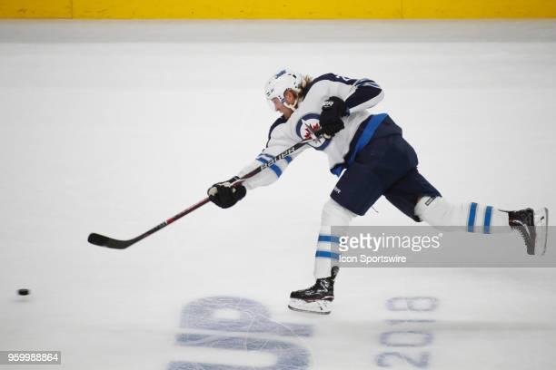 Winnipeg Jets right wing Patrik Laine takes a shot during Game Four of the Western Conference Finals of the 2018 NHL Stanley Cup Playoffs between the...
