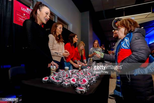 Winnipeg Jets Wives Emily Byfuglien Sam Wheeler and Jenny Perreault help sell autographed pucks in support of Camp Manitou prior to NHL action...