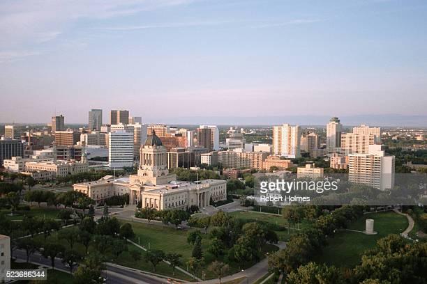 winnipeg legislative building and urban surroundings - winnipeg stock pictures, royalty-free photos & images