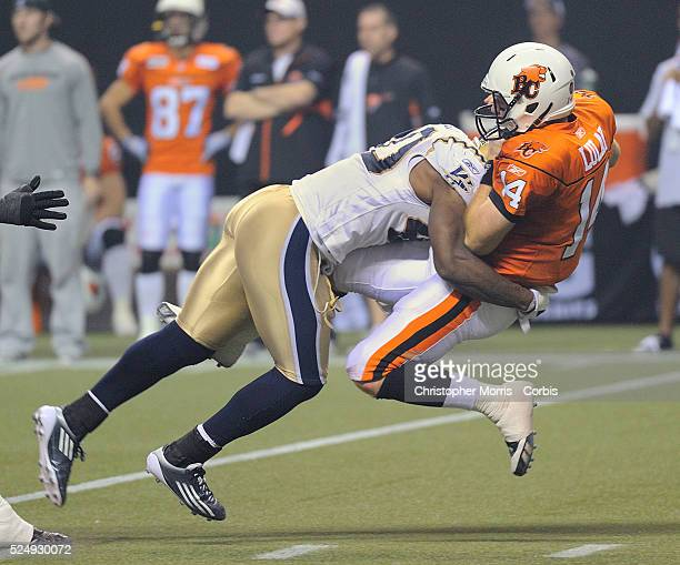 Winnipeg's Odell Willis tackles Vancouver's quarterback Travis Lulay during secondhalf action between the BC Lions and the Winnipeg Blue Bombers at...