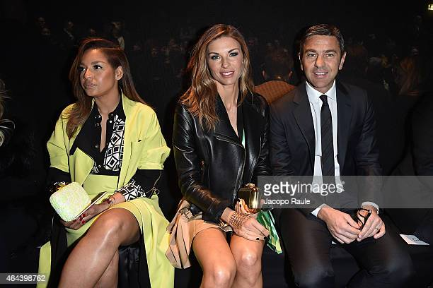 Winona de Jong Martina Colombari and Alessandro Costacurta attend the Fausto Puglisi show during the Milan Fashion Week Autumn/Winter 2015 on...