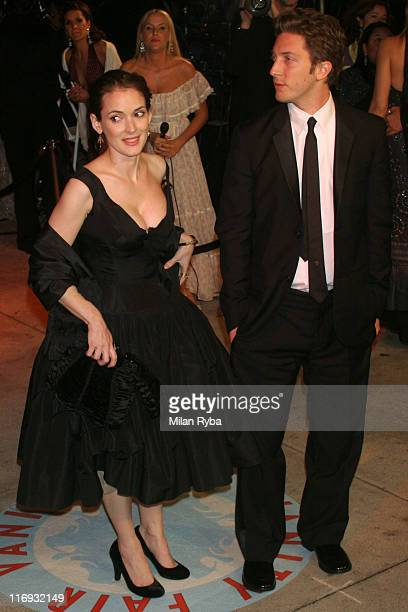 Winona Ryder and guest during 2006 Vanity Fair Oscar Party at Morton's in West Hollywood California United States