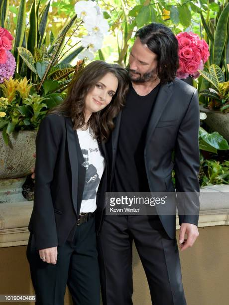 Winona Ryder and Keanu Reeves attend a photo call for Regatta's Destination Wedding at the Four Seasons Hotel Los Angeles at Beverly Hills on August...