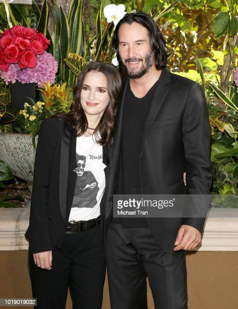 Victor Levin Winona Ryder and Keanu Reeves attend the photo call for Regatta's 'Destination Wedding' held at Four Seasons Hotel Los Angeles at...