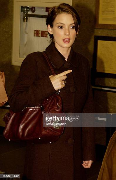 Winona Ryder is seen through a tinted glass as she arrives at Beverly Hills Superior Court for her trial on charges of alleged grand theft,...
