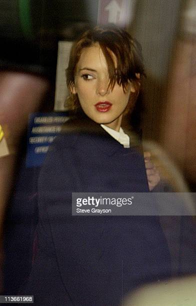 Winona Ryder is seen through a tinted glass as she arrives at the Beverly Hills Superior Court for her trial on charges of alleged grand theft,...
