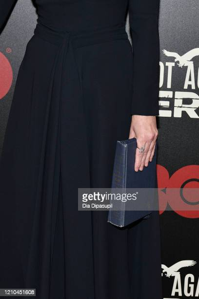 Winona Ryder purse detail attends HBO's The Plot Against America premiere at Florence Gould Hall on March 04 2020 in New York City