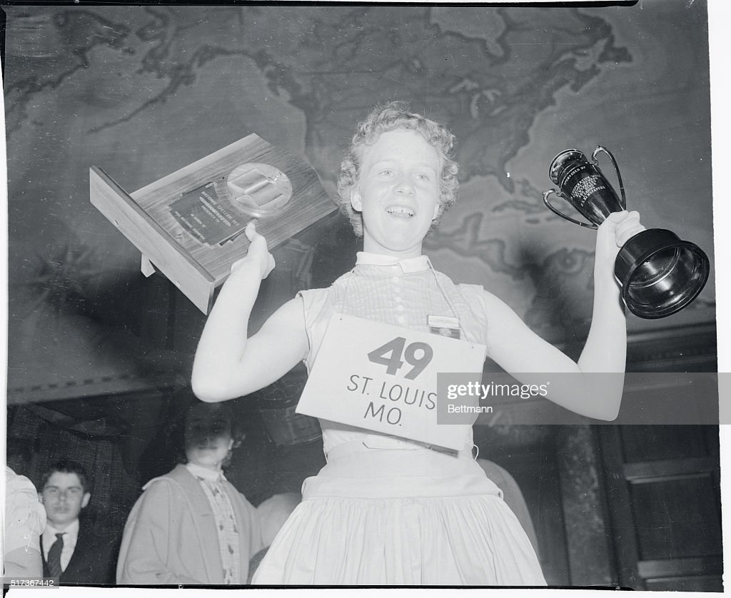 Girl Holding Trophy Cup and Plaque : News Photo
