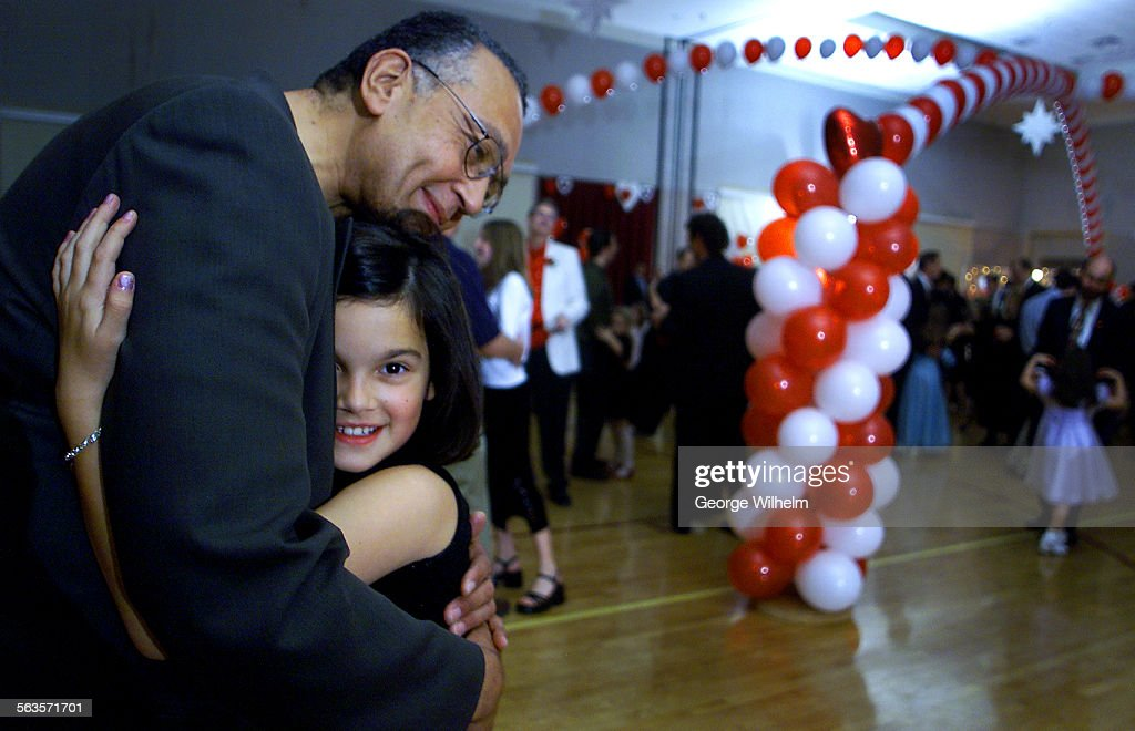 2/8/2002 – Winston Bowman enjoys a dance with his 9–year–old daughter, Katherine, at a community org : News Photo
