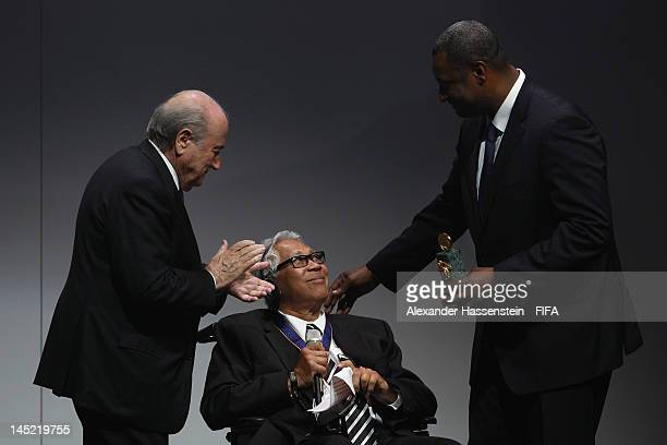 Winston Chung receives the Order of Merit Award from FIFA President Joseph S Blatter and CONCACAF President Jeffrey Webb during the Opening Ceremony...