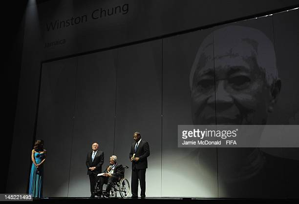 Winston Chung receives the Order of Merit Award from FIFA President Joseph S Blatter and CONCACAF President Jeffrey Webb during the 62nd FIFA...