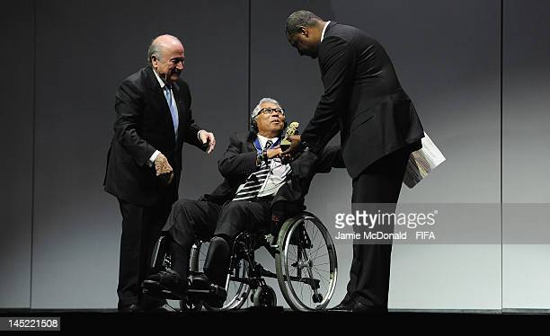 Winston Chung receives the Order of Merit Award from FIFA President Joseph Sepp Blatter and CONCACAF President Jeffrey Webb during the 62nd FIFA...