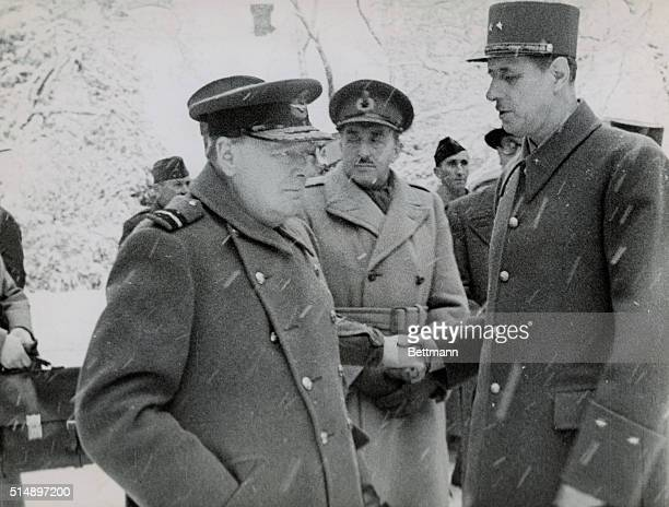 Winston Churchill and General Charles de Gaulle visit the headquarters of the French first Army near Bemancon, France. They are conferring with...