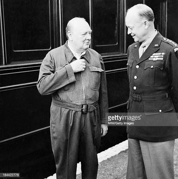 Winston Churchill As Prime Minister 19401945 Home Front Churchill demonstrating the zipper on his famous siren suit to General Dwight D Eisenhower...