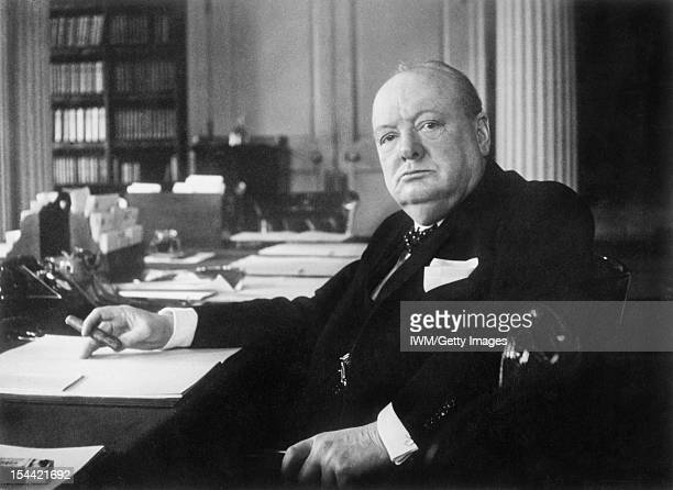 Winston Churchill As Prime Minister 19401945 Winston Churchill at his seat in the Cabinet Room at No 10 Downing Street London circa 1940
