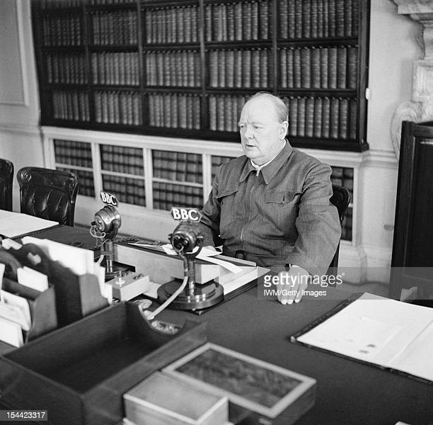 Winston Churchill As Prime Minister 19401945 Winston Churchill makes a radio address from his desk at 10 Downing Street wearing his 'siren suit' June...