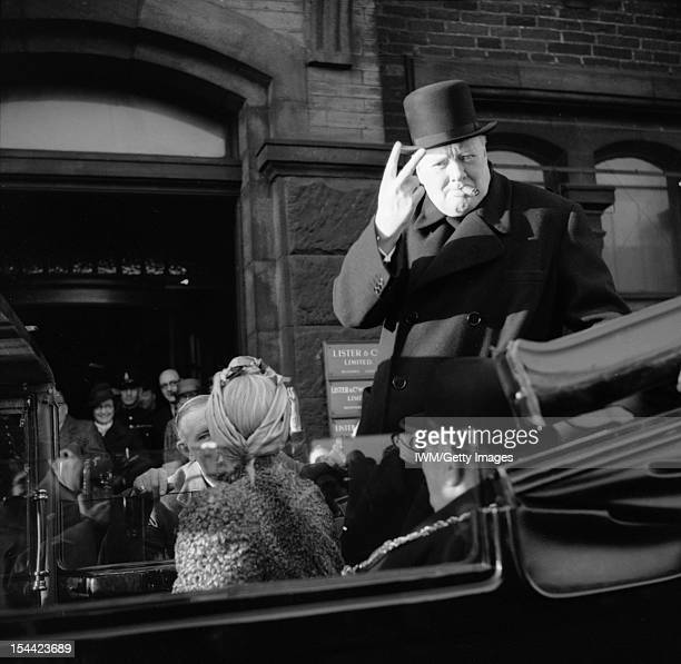 Winston Churchill As Prime Minister 1940-45, Churchill, cigar in mouth, gives his famous 'V' for victory sign during a visit to Bradford, 4 December...