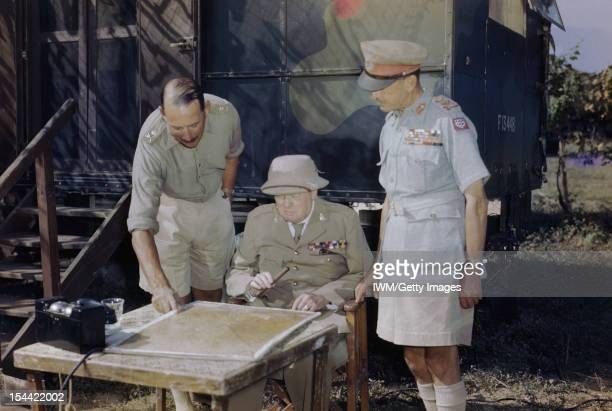Winston Churchill At Eighth Army Headquarters In Italy 26 August 1944 The Prime Minister the Rt Hon Winston Churchill MP discussing the battle...