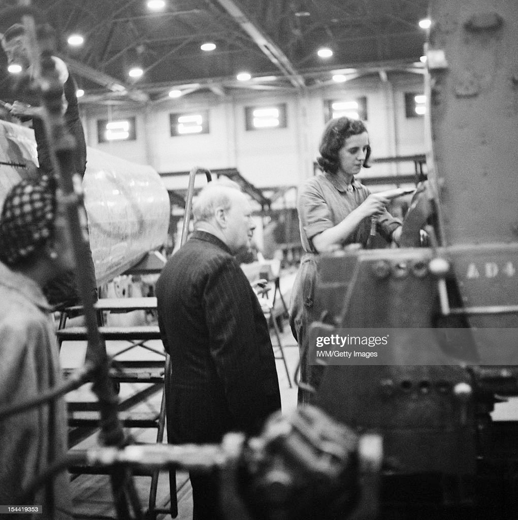 Winston Churchill During The Second World War In The United Kingdom, The Prime Minister Winston Churchill observes a female riveter working on a Supermarine Spitfire at the Castle Bromwich factory in Birmingham, England, on 28 September 1941.
