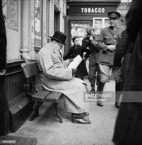 Winston Churchill During The Second World War In The United Kingdom The Prime Minister Winston Churchill reads a newspaper on the platform while...
